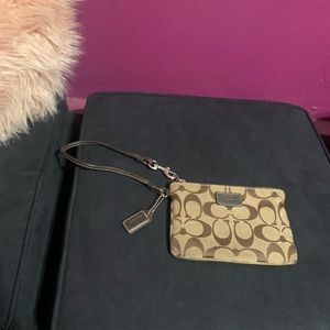 Small Coach Wristlet in Brown Signature C Fabric